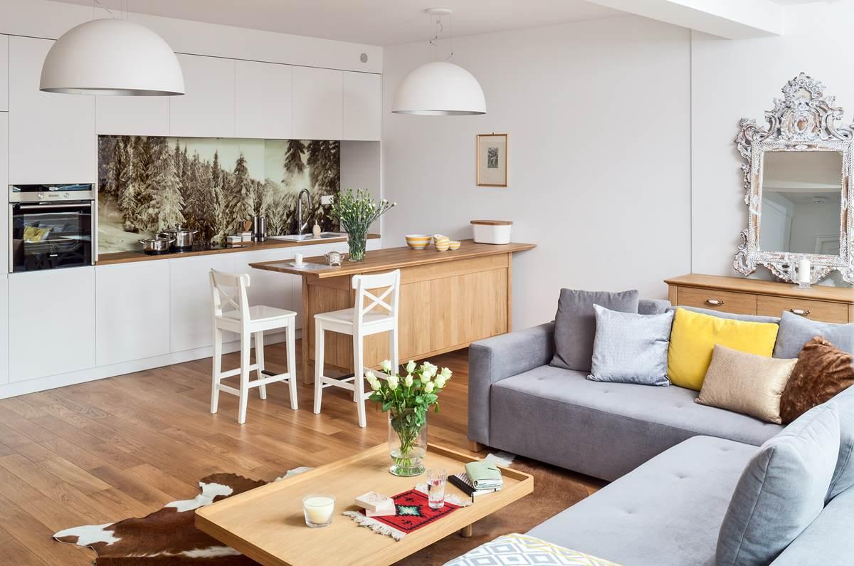 Elegancki apartament w Zakopanem kanapa w Salonie klimatyczne wnętrza szukam architekta urządzamy dom inspiracje piękne wnętrza salon z kuchnią wyspa w kuchni architekt wnętrz Zakopane Sopot Warszawa fototapeta w kuchni grafika